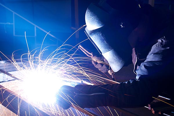 A mechanical contractor welding.