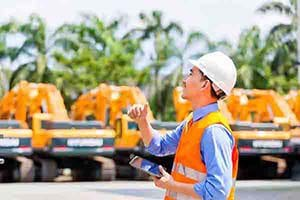 Manager uses equipment rental software to check on site machines.
