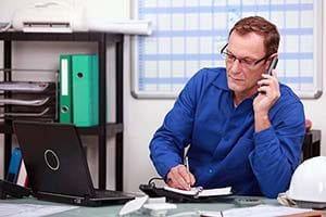 A service contractor using software to complete billing.