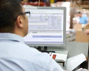 HVAC dispatcher using service work order management software.