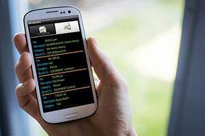 A mobile phone running TechAnywhere field service software for contractors.
