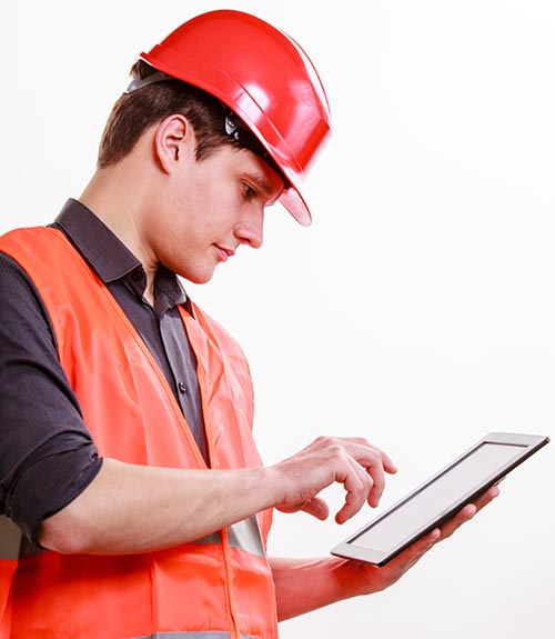 HVAC contractor using a tablet to enter labor data into construction time tracking software.