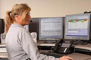 Service dispatcher using SAMPro field service software for contractors.