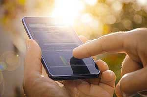 SAMPro integrated business analytics software running on a smartphone.