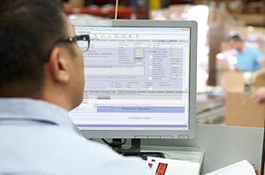 A contractor using work order management software.